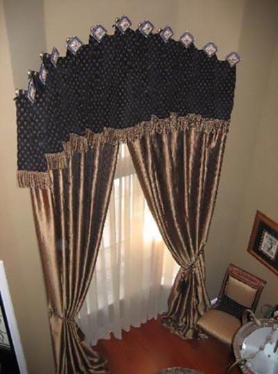 Dramatic Medallion Mounted Fringe Trim Top Treatment w Puddled Gold Draperies