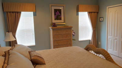 bedroom with window treatment