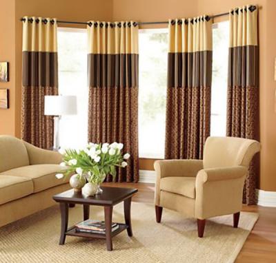 modern custom drapery on decorative poles and grommets