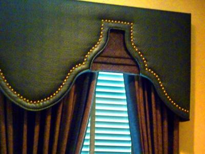 Studded Shaped Cornice over layered Custom Shade and Gathered Drapery Panels