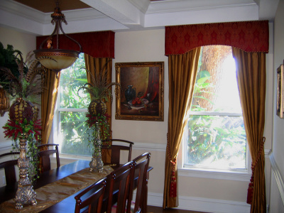 red cornice with gold curtains