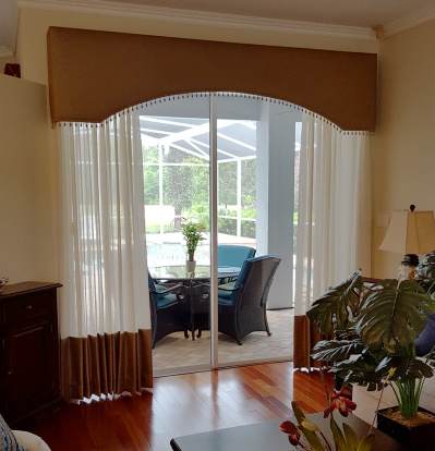 Arched Upholstered Cornice over coordinated sheer draperies
