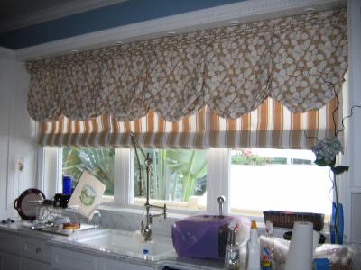 Inviting kitchen top treatment - Balloon Valance over coordinated Roman Shades