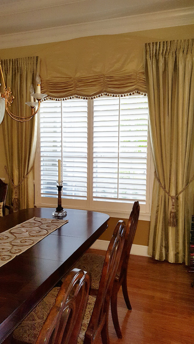Formal dining room Gold drapery with Traditional Shutters