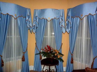 ornate blue top treatment and drapes