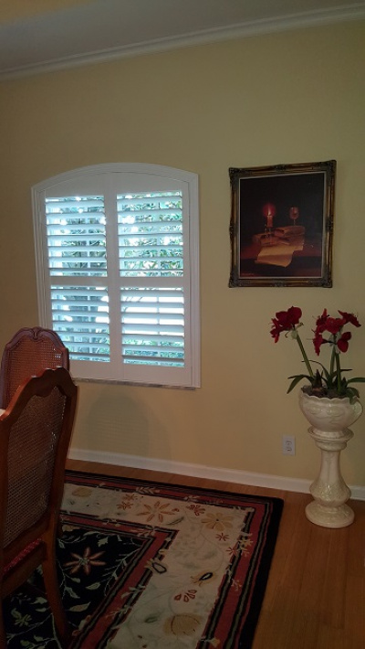 arched plantation shutters