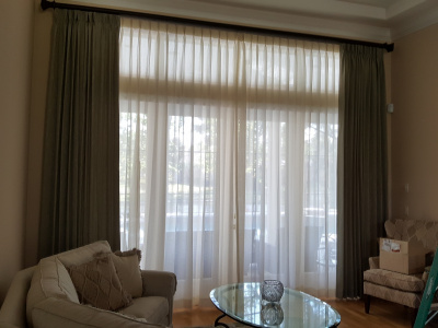 That's Better!  Family room with Drapes & Sheers
