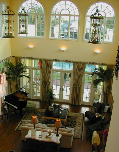 two story room with green drapery