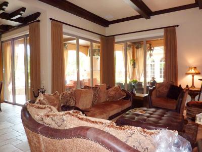 Elegant Family room with Decorative Traversing draperies